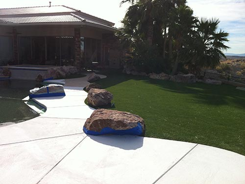 pool landscaping with boulders